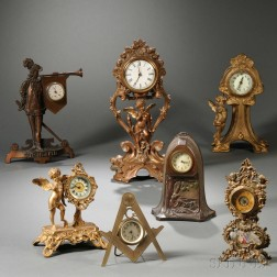 Seven Cast Metal Novelty Clocks
