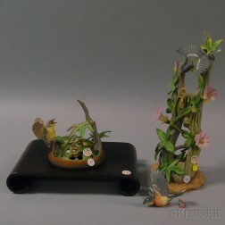 Two Porcelain Boehm Bird Figures and a Scrolled Wooden Stand