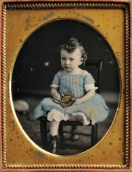 American School, 19th Century      Hand-tinted Quarter-plate Daguerreotype of a Child Holding a Photographic Case