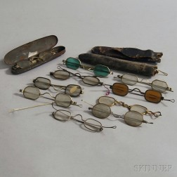 Group of Early Spectacles, Sunglasses, and Cases.     Estimate $150-250