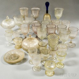 Approximately Thirty-four Pieces of Colorless Grapevine-pattern Pressed Glass.     Estimate $300-500