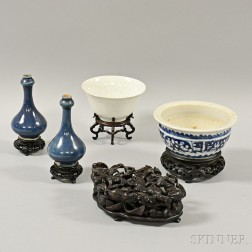 Four Ceramic Items and a Wood Stand
