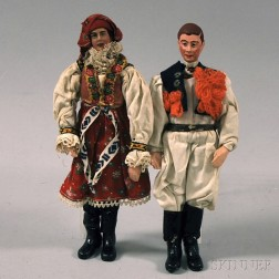 Painted Figures of a Man and a Woman in Traditional Dress