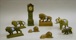 Seven Metal Animal Figurals and a Waterbury Miniature Metal Tall Case Clock