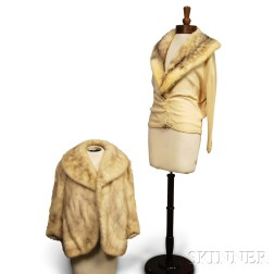 Cream Cashmere Cardigan with Ermine Collar and a White Fox Fur Jacket.     Estimate $100-150
