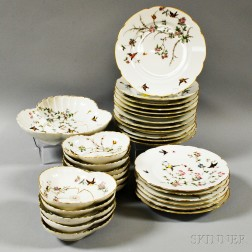 Thirty Pieces of Limoges Porcelain Bird-decorated Tableware.     Estimate $200-250