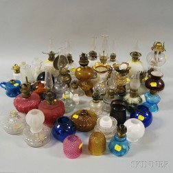 Group of Small Colored and Colorless Glass Lamps and Lamp Parts