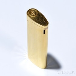 Lighter, Tiffany & Co., in ribbed gold-tone metal, lg. 3 1/8 in., signed.