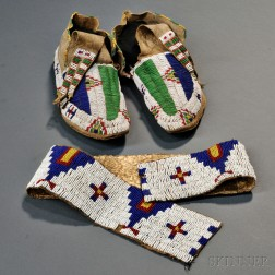 Pair of Lakota Buffalo Hide Moccasins and a Single Legging Strip