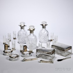 Liquor and Smoking Set, Frankfurt, early 20th century, Posen, maker, monogrammed, silver-mounted glass items including three decanters,