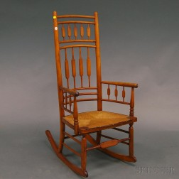 William White Maple Arrow-back Windsor Armed Rocker and a Southwest Caucasian Rug