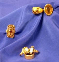 Four Gem-set Rings, Cameo Ring, and a Gold Band.