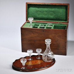 Mahogany Liquor Box, England, 19th century, the dovetailed case with felt-lined compartments for an etched glass decanter and six match