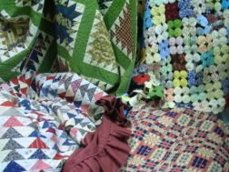 Three-Color Overshot Coverlet and Three Pieced Cotton Quilts.