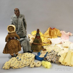 Three African-American Dolls and Miscellaneous Doll Clothing