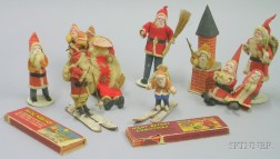 Thirteen Cloth and Composition Santas and Related Items