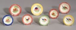 Eight Small Staffordshire Spatterware Decorated Cup Plates