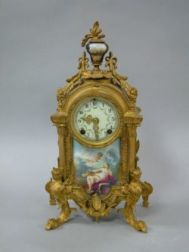 New Haven Clock Co. Louis XV Style Gilt Bronze and Scenic Decorated Porcelain Mantel Clock.