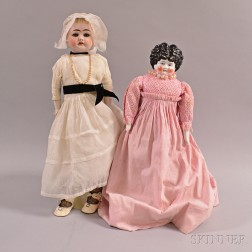 China Head Doll and an Ernst Heubach Bisque Head Doll