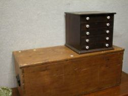 Pine Six-Board Storage Chest and a Small Walnut Five-Drawer Sewing Cabinet.