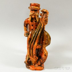 Redware Pottery Figure of a Bearded Man Playing Cello