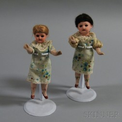 Two Small German All-bisque Socket-head Girl Dolls