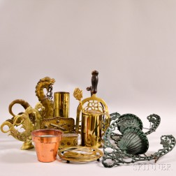 Twelve Mostly Brass Decorative Accessories.     Estimate $40-60