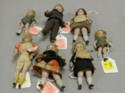 Six Glass-Eyed Dollhouse Scale All-Bisque Child Dolls and a Painted-Eye Lady