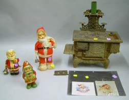 "Toy Cast Iron ""Eagle"" Stove, Three Wind-up Santa Figures, and Two Printed Portraits   of Santa on Silk"