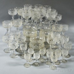 Approximately Sixty Pieces of Etched Grapevine-pattern Crystal Stemware and Finger Bowls.     Estimate $250-350