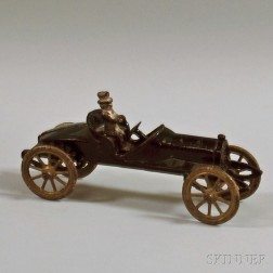 Small Black-painted Cast Iron Toy Car with Seated Metal Driver