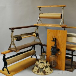 Eight Wood and Iron Paper Holders, a Coffee Grinder, and a Christmas Tree Stand.     Estimate $250-350