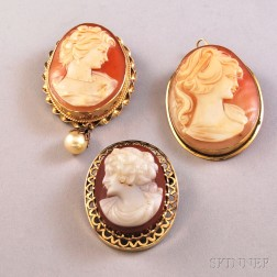 Three Gold-framed Cameo Pendant/Brooches