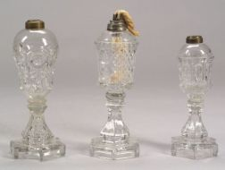 Three Colorless Pressed Glass Fluid Lamps