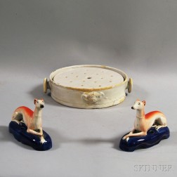 French White Faience Two-piece Plate Warmer and a Pair of Staffordshire Greyhound   Whippet Figures