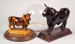 Two Portuguese Brown Glazed Pottery Bull Figural Liquor Dispensers