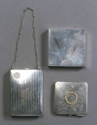 Three Sterling Compacts