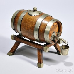 Small Oak Cask on Stand, England, early 20th century, the barrel, cork top, and canted stand mounted with brass, the cask lined and wit