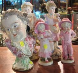 Two Pairs of German Polychrome Decorated Bisque Figures of Children and a Modern Vienna-style Porcelain Portrait Bust
