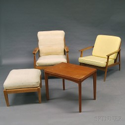 Two Danish Modern Lounge Chairs, an Ottoman, and a Side Table