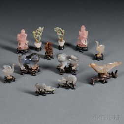 Twelve Miniature Stone Carvings on Wood Stands