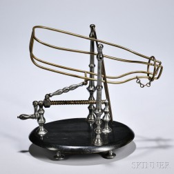 Wine Decanting Machine and Cradle, 20th century, brass wire and turned pewter, with crank-driven screw attached to a double-hinged arm
