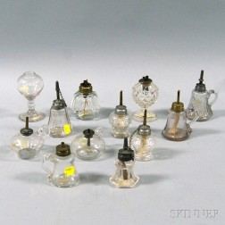 Twelve Colorless Blown and Pressed Glass Sparking and Hand Lamps