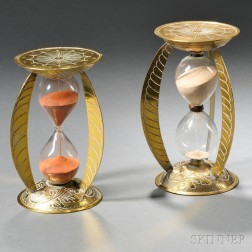 Near Pair of Brass and Glass Hourglasses