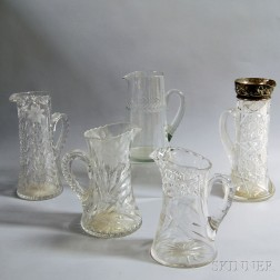 Five Etched and Cut Glass Pitchers