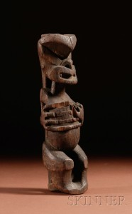 Sold for: $11,258 - Maori Carved Wood Figure