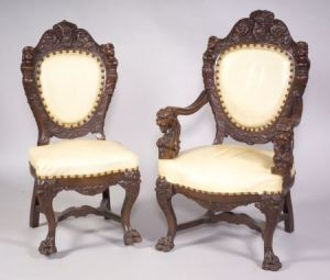 Sold for: $43,475 - Set of Ten Renaissance Revival Carved Oak Dining Chairs