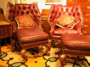 pair of charles pollock rococostyle tufted leather upholstered carved beech wing chairs and ottoman