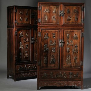 Sold for: $21,600 - Pair of Compound Cabinets