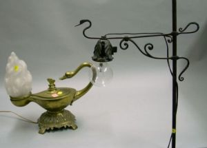 Search all lots skinner auctioneers wrought iron floor lamp and a brass plated cast metal aladdin type table lamp aloadofball Image collections